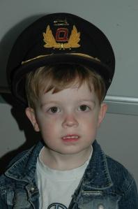 Captain Newton...the Captain lends Mister his real Qantas Captain's Hat.