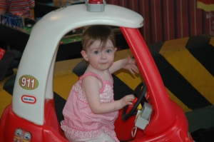 Miss driving in the Nippers' Railway play area in 2007 aged 1.