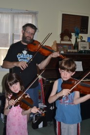 The family playing violin