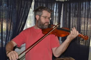 Geoff playing the violin.