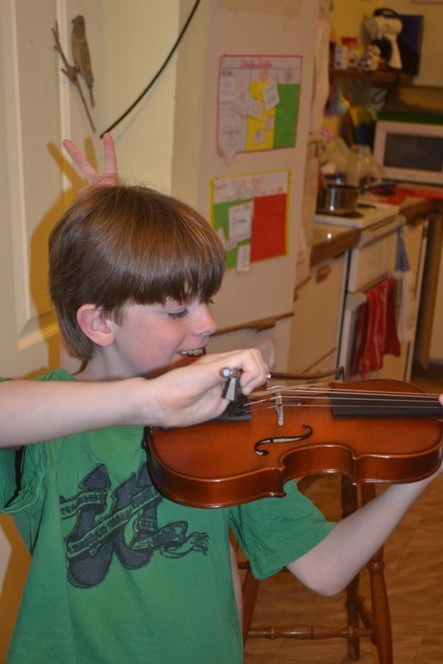 Jonathon smiling violin