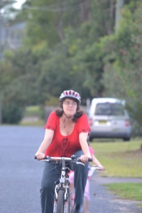 Mummy riding her bike.
