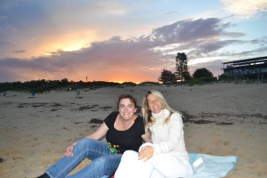 Friends at the beach at sunset