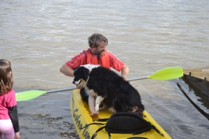 Bilbo out on the kayak with Geoff.