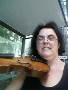 A selfie of me playing my violin in the bus shelter, Sydney.
