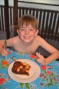 Mister eating his Ham & Pineapple Pizza.
