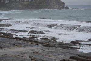 After the crash, the waves flow over the rocks like spillt milk.