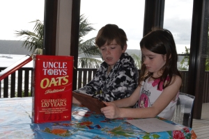 The kids play games on the ipad waiting for the tin of oats to magically refill.
