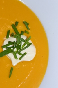 Pumpkin Soup with sour cream and chives.