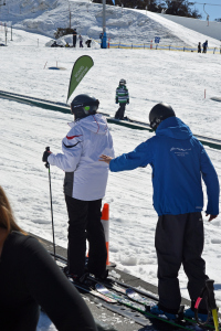 MY instructor helping me up the magic carpet on my first ski lesson in 2013.