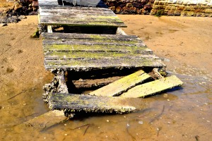 """Surprisingly, there are a few rather dead looking boat ramps along the waterfront. They remind me of Wordsworth's poem: """"The Deserted Village"""". I also see this as the seas reclaiming its ground. Mankind thinks we can tame the sea but..."""