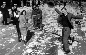 "This iconic photo known as ""Dancing Man"" was taken in Elizabeth Street,  Martin Place celebrating the end of WWII on 15 August, 1945."