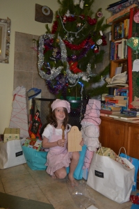The ultimate Christmas gift: our daughter under the Christmas tree wearing her baking attire 2013.