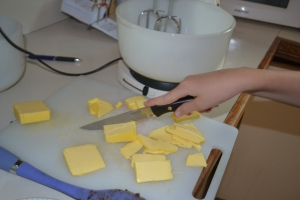 "Mister cuts the butter into ""slices of bread""."