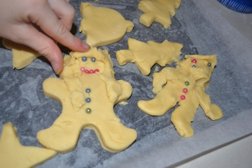 Shortbread Miss and Mister complete with hair and shiny buttons