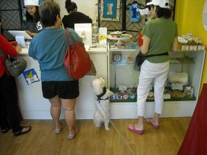 Max is a good shopper who stands in line to wait his turn. That's the AJF on the right.