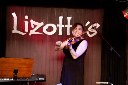 Posing after our violin performance 2012. Lizotte's is a rock n' roll venue where the likes of Diesel have performed...and me! The music school hired the venue for our concert.
