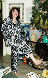 Showing off my new zebra PJs from Victoria's Secret beside the Christmas Tree in 2006. Lucky I didn't go skiing on all that wrapping paper!