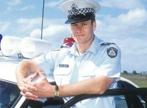 William McInnes in uniform in the hit Australian TV series Blue Heelers.