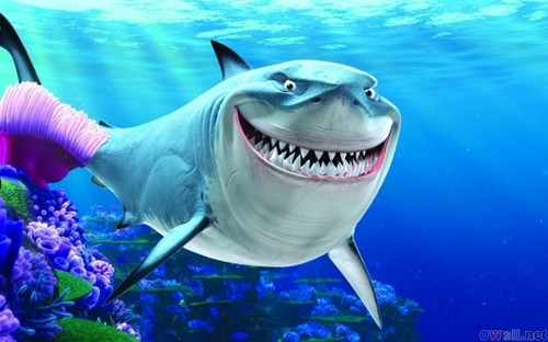 Bruce the Shark smiling at the fish.