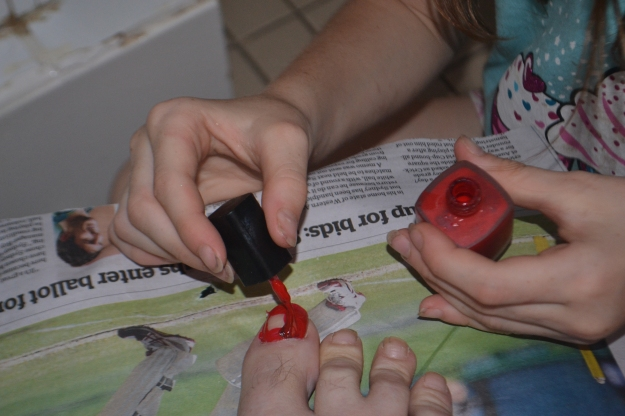 My daughter painting my nails.