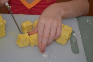 Dicing the butter.