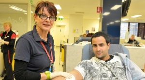 A blood donor and nurse.