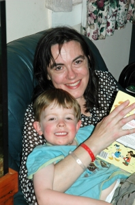Mister and I reading during my 7 week hospital stint in 2007 when I was diagnosed with dermatomyositis.
