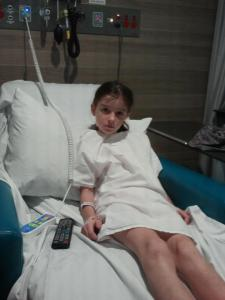 Miss in hospital waiting for her endoscopy. So brave but she also loved having her own remote control TV!!