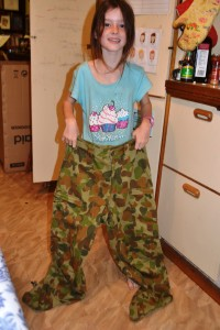 Miss is dwarfed by the army pants.