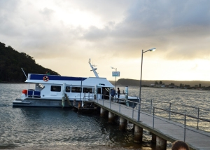 The Palm Beach Ferry returns to near deserted wharf at Ettalong as the weekend draws to a close.