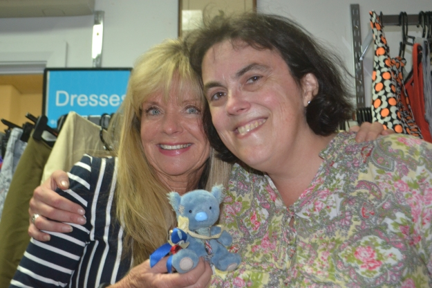 Sharon and I introduce Wandering Wally to op shopping. Wally has flown all the way from the UK to raise awareness of myositis, the muscle disease I live with.