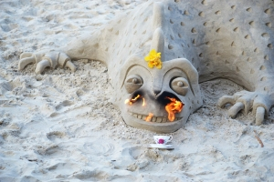 We met a guy who is a world class sandcastle builder and I offered his dragon a cup of tea.