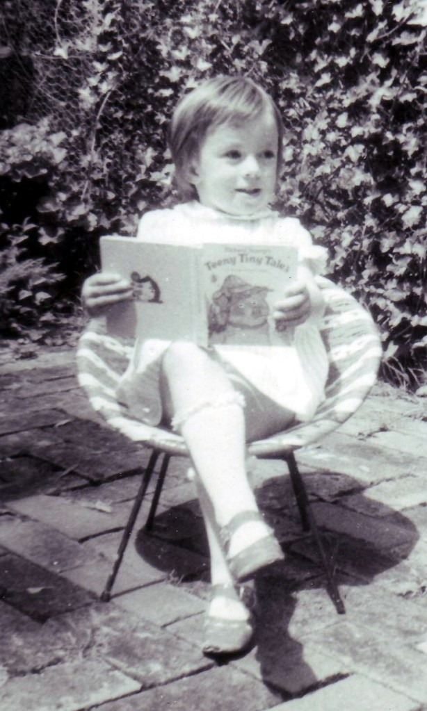 Here I am reading at about age 5 or 6...good preparation for becoming a writer.
