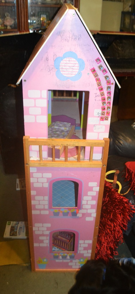 Our daughter's impressive three-storey doll's house is on the move.