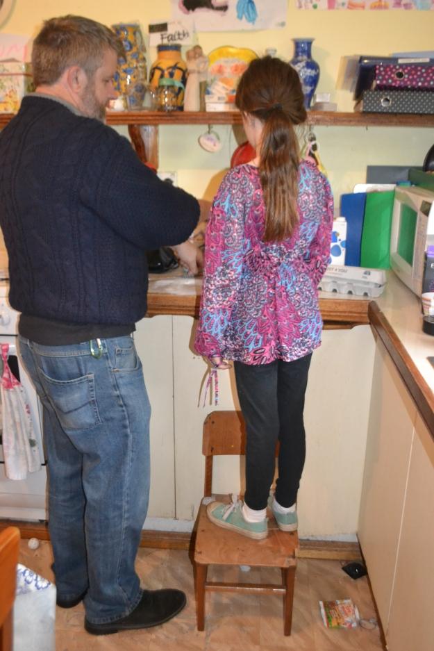 Geoff helping Miss make the pancake mix.