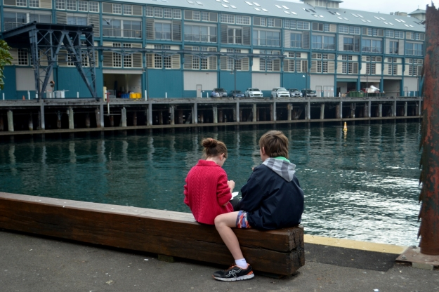 The Kids Seated behind Harry's and looking at Cowper Bay Wharf, Wooloomooloo.