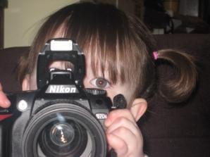 Amelia with Nikon camera aged 2.5