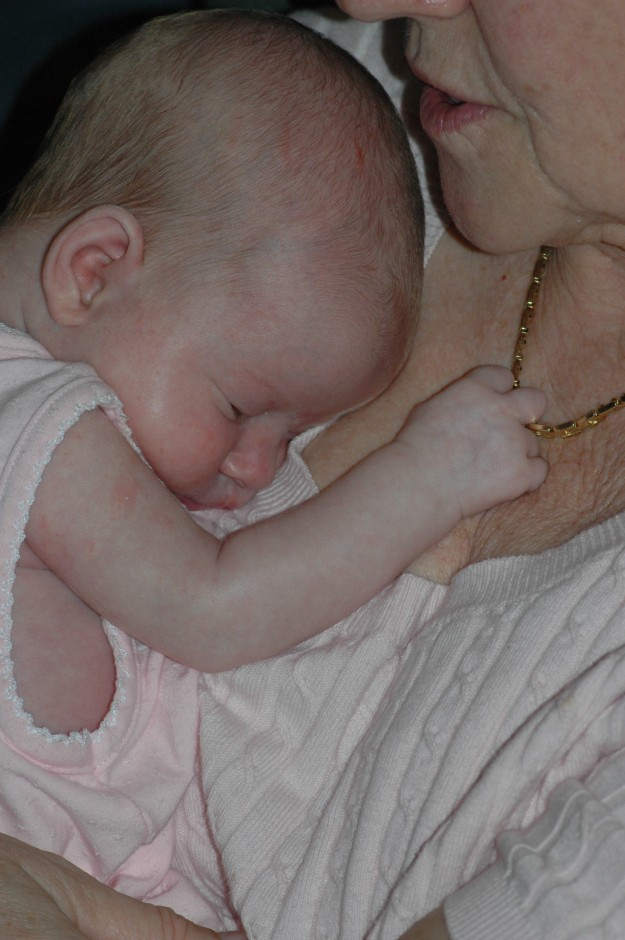 Even in her sleep, Miss isn't letting go of Grandma's necklace.
