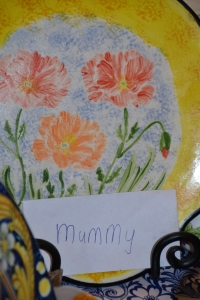 """A ceramic plate I painted andan envelope written by Miss is hardly """"clutter""""."""