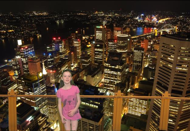 Miss in front of a Sydney nightscape.