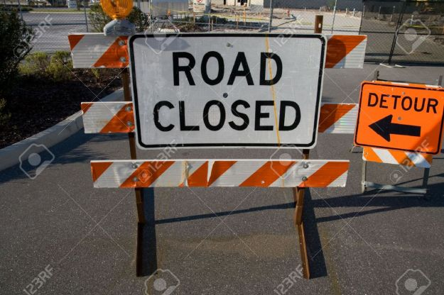 2157931-Road-closed-and-detour-signs-on-road-barriers-Stock-Photo