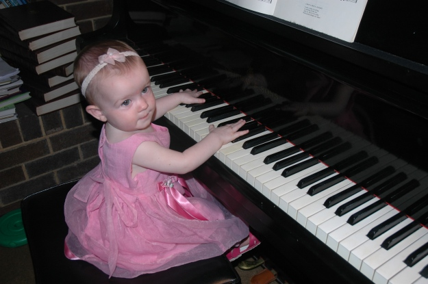 Miss playing my mother's grand piano, aged 1.