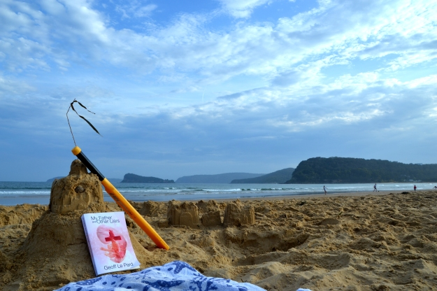 After playing a spot of beach cricket, the book sunbakes at Umina Beach, North of Sydney.