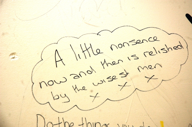 Philosophy adorning the toilet wall.
