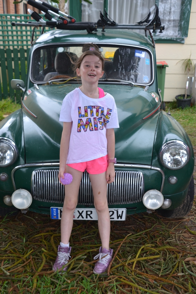 Little Miss in front of our Morris Minor.