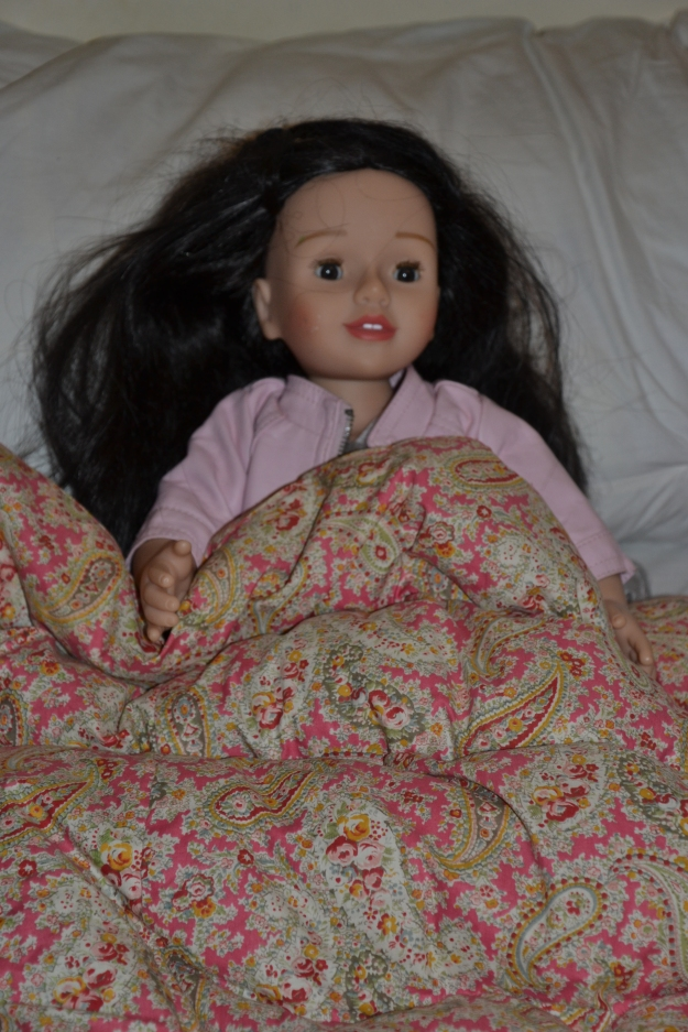 Doll in bed