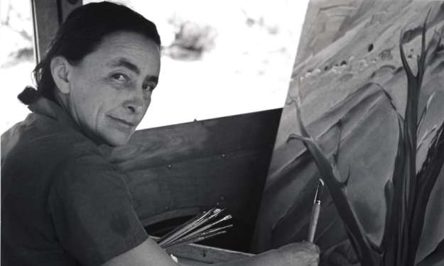 Georgia O'Keeffe Painting in her car at Ghost Ranch New Mexico