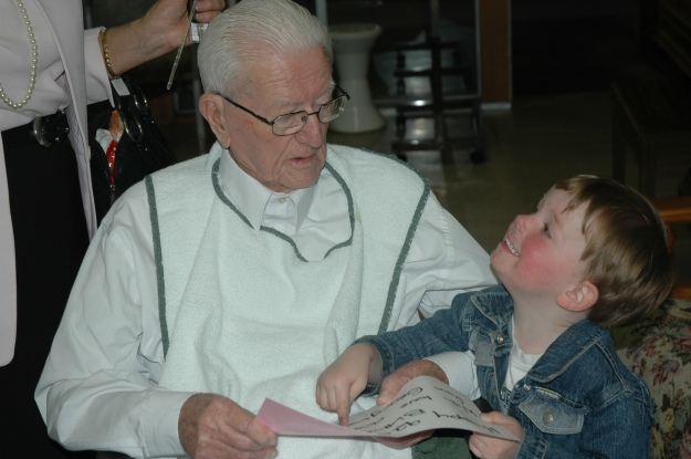 Jonathon teaching Papa Bert to read